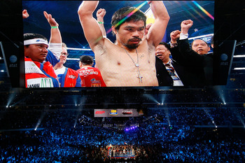 ARLINGTON, TX - NOVEMBER 13:  The likeness Manny Pacquiao (white trunks) of the Philippines is seen on the giant screen as he is introduced prior to fighting against Antonio Margarito (black trunks) of Mexico during their WBC World Super Welterweight Titl
