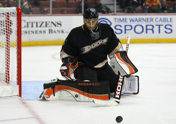 ANAHEIM, CA - JANUARY 02:  Goaltender Jonas Hiller #1 of the Anaheim Ducks makes a save in the second period during the NHL game against the Chicago Blackhawks at Honda Center on January 2, 2011 in Anaheim, California. The Ducks defeated the Blackhawks 2-