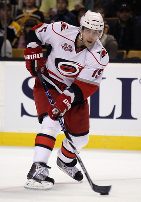 BOSTON - NOVEMBER 26:  Tuomo Ruutu #15 of the Carolina Hurricanes takes the puck in the second period against the Boston Bruins on November 26, 2010 at the TD Garden in Boston, Massachusetts.  (Photo by Elsa/Getty Images)