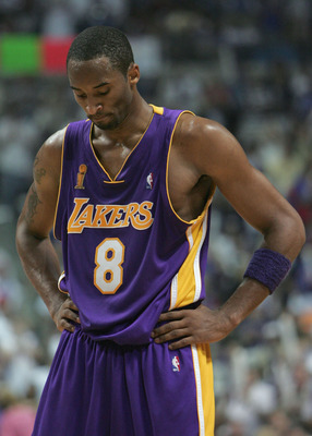 AUBURN HILLS, MI - JUNE 15:  Kobe Bryant #8 of the Los Angeles Lakers hangs his head in dejection in the fourth quarter of game five of the 2004 NBA Finals against the Detroit Pistons on June 15, 2004 at The Palace of Auburn Hills in Auburn Hills, Michiga