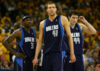 OAKLAND, CA - MAY 03:  Dirk Nowitizki #41, Jason Terry #31 and Austin Croshere #44 of the Dallas Mavericks look on against the Golden State Warriors in Game 6 of the Western Conference Quarterfinals during the 2007 NBA Playoffs on May 3, 2007 at Oracle Ar