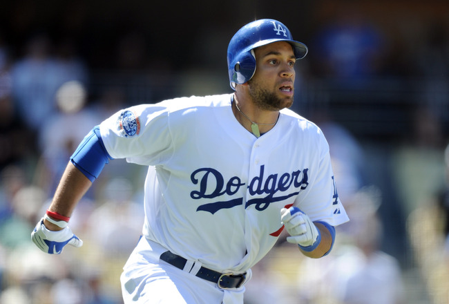 LOS ANGELES, CA - SEPTEMBER 01:  James Loney #7 of the Los Angeles Dodgers runs to first base against the Philadelphia Phillies at Dodger Stadium on September 1, 2010 in Los Angeles, California.  (Photo by Harry How/Getty Images)