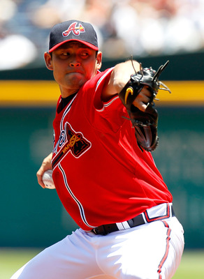 ATLANTA - JUNE 20:  Starting pitcher Kenshin Kawakami #11 of the Atlanta Braves pitches against the Kansas City Royals at Turner Field on June 20, 2010 in Atlanta, Georgia.  (Photo by Kevin C. Cox/Getty Images)