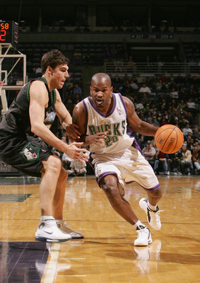 MILWAUKEE - FEBRUARY 1:  Erick Strickland #20 of the Milwaukee Bucks drives against Wally Szczerbiak #10 of the Minnesota Timberwolves on February 1, 2005 at Bradley Center in Milwaukee, Wisconsin. The Bucks defeated the Wolves 91-86.  NOTE TO USER: User