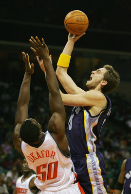 CHARLOTTE - JANUARY 14:   Pau Gasol #16 of the Memphis Grizzlies shoots over Emeka Okafo #50 of the Charlotte Bobcats during the game on January 14, 2005 at the Charlotte Coliseum in Charlotte, North Carolina. The Grizzlies defeated the Bobcats 109-89.  N