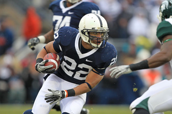 STATE COLLEGE, PA - NOVEMBER 27: Running back Evan Royster #22 of the Penn State Nittany Lions carries the ball during a game against the Michigan State Spartans on November 27, 2010 at Beaver Stadium in State College, Pennsylvania. The Spartans won 28-22