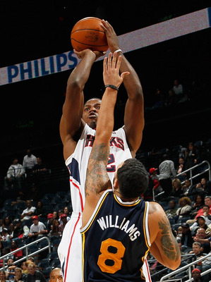 ATLANTA - NOVEMBER 12:  Joe Johnson #2 of the Atlanta Hawks shoots over Deron Williams #8 of the Utah Jazz at Philips Arena on November 12, 2010 in Atlanta, Georgia.  NOTE TO USER: User expressly acknowledges and agrees that, by downloading and/or using t