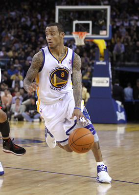 OAKLAND, CA - DECEMBER 20:  Monta Ellis #8 of the Golden State Warriors in action against the Houston Rockets at Oracle Arena on December 20, 2010 in Oakland, California. NOTE TO USER: User expressly acknowledges and agrees that, by downloading and or usi