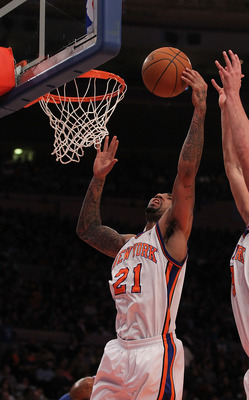 NEW YORK - DECEMBER 22:  Wilson Chandler #21 of the New York Knicks in action against  the Oklahoma City Thunder at Madison Square Garden on December 22, 2010 in New York, New York.   NOTE TO USER: User expressly acknowledges and agrees that, by downloadi