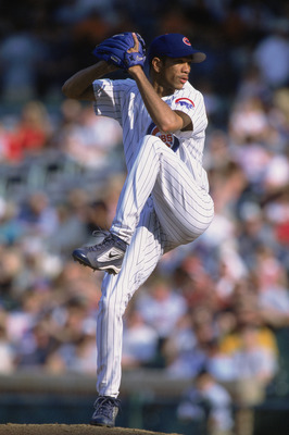 CHICAGO - AUGUST 30:  Juan Cruz #51 of the Chicago Cubs prepares to pitch the ball during their game against the St. Louis Cardinals at Wrigley Field in Chicago, Illinois on August 30th 2002. The Cardinals defeated the Cubs 6-3. (Photo by:  Jonathan Danie