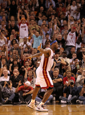 MIAMI, FL - JANUARY 04:  LeBron James #6 of the Miami Heat reacts after James Jones #22 hit a 3 pointer late in the game against the Milwaukee Bucks at American Airlines Arena on January 4, 2011 in Miami, Florida. NOTE TO USER: User expressly acknowledges