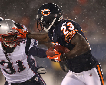 CHICAGO - DECEMBER 12: Devin Hester #23 of the Chicago Bears runs against Brandon Meriweather #31 of the New England Patriots at Soldier Field on December 12, 2010 in Chicago, Illinois. The Patriots defeated the Bears 36-7. (Photo by Jonathan Daniel/Getty
