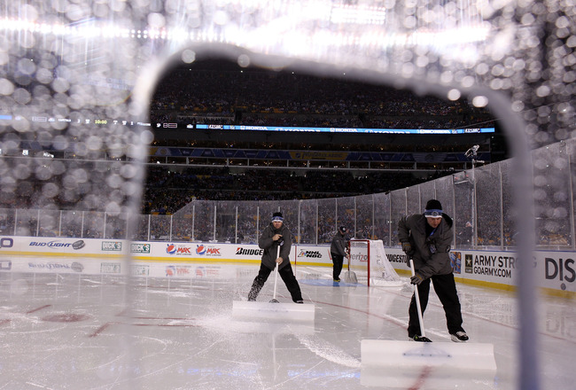 PITTSBURGH, PA - JANUARY 01:  Members of the ice crew maintain the ice during the 2011 NHL Bridgestone Winter Classic between the Washington Capitals and the Pittsburgh Penguins at Heinz Field on January 1, 2011 in Pittsburgh, Pennsylvania.  (Photo by Jam