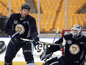 PITTSBURGH, PA - DECEMBER 31:  Jordan Staal #11 of the Pittsburgh Penguins deflects a puck on Brent Johnson #1 during the 2011 NHL Winter Classic Practice on December 31, 2010 at Heinz Field in Pittsburgh, Pennsylvania.  (Photo by Justin K. Aller/Getty Im