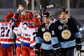 PITTSBURGH, PA - JANUARY 01:  The Washington Capitals celebrate their 3-1 victory as the Pittsburgh Penguins leave the ice during the 2011 NHL Bridgestone Winter Classic at Heinz Field on January 1, 2011 in Pittsburgh, Pennsylvania.  (Photo by Jamie Sabau