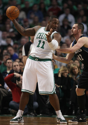 BOSTON, MA - JANUARY 03:  Glen Davis #11 of the Boston Celtics heads for the basket as Kevin Love #42 of the Minnesota Timberwolves defends on January 3, 2011 at the TD Garden in Boston, Massachusetts. NOTE TO USER: User expressly acknowledges and agrees