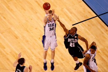 INDIANAPOLIS - APRIL 05:  Kyle Singler #12 of the Duke Blue Devils attempts a shot against Willie Veasley #21 of the Butler Bulldogs during the 2010 NCAA Division I Men's Basketball National Championship game at Lucas Oil Stadium on April 5, 2010 in India