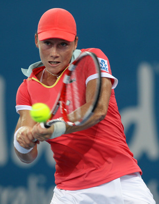 BRISBANE, AUSTRALIA - JANUARY 03:  Samantha Stosur of Australia plays a backhand during her first round match against Lucie Hradecka of the Czech Republic during day two of the Brisbane International at Queensland Tennis Centre on January 3, 2011 in Brisb