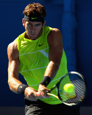 MELBOURNE, AUSTRALIA - JANUARY 24:  Juan Martin Del Potro of Argentina plays a backhand in his fourth round match against Marin Cilic of Croatia during day seven of the 2010 Australian Open at Melbourne Park on January 24, 2010 in Melbourne, Australia.  (