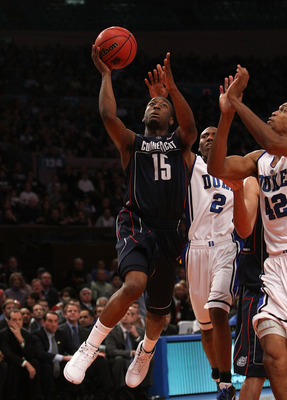 NEW YORK - NOVEMBER 27:  Kemba Walker #15 of the Connecticut Huskies shoots the ball against the Duke Blue Devils  during the Championship game at Madison Square Garden on November 27, 2009 in New York, New York.  (Photo by Nick Laham/Getty Images)