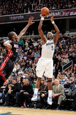WASHINGTON, DC - DECEMBER 18:  Josh Howard #5 of the Washington Wizards shoots a jump shot against the Miami Heat at the Verizon Center on December 18, 2010 in Washington, DC. NOTE TO USER: User expressly acknowledges and agrees that, by downloading and o