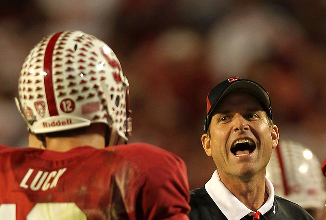 MIAMI, FL - JANUARY 03: Head coach Jim Harbaugh of the Stanford Cardinal celebrates a play with Andrew Luck #12 against the Virginia Tech Hokies during the 2011 Discover Orange Bowl at Sun Life Stadium on January 3, 2011 in Miami, Florida. Stanford won 40