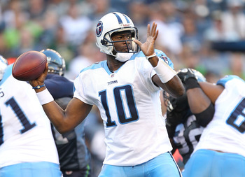 SEATTLE - AUGUST 14:  Quarterback Vince Young #10 of the Tennessee Titans passes during the preseason game against the Seattle Seahawks at Qwest Field on August 14, 2010 in Seattle, Washington. (Photo by Otto Greule Jr/Getty Images)