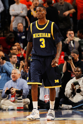 INDIANAPOLIS - MARCH 12:  Guard Manny Harris #3 of the Michigan Wolverines reacts after losing in the final seconds of their quarterfinal game against the Ohio State Buckeyes in the Big Ten Men's Basketball Tournament at Conseco Fieldhouse on March 12, 20