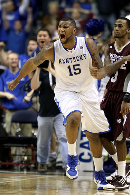 NASHVILLE, TN - MARCH 14:  DeMarcus Cousins #15 of the Kentucky Wildcats celebrates after he made a 2-point basket at the end of regulation to tie the game and send it to overtime against the Mississippi State Bulldogs during the final of the SEC Men's Ba