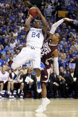 NASHVILLE, TN - MARCH 14:  Eric Bledsoe #24 of the Kentucky Wildcats drives for a shot attempt against Barry Stewart #22 of the Mississippi State Bulldogs during the final of the SEC Men's Basketball Tournament at the Bridgestone Arena on March 14, 2010 i
