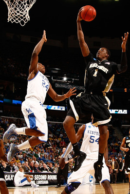 NEW ORLEANS - MARCH 20:  Al-Farouq Aminu #1 of the Wake Forest Demon Deacons makes a shot over Eric Bledsoe #24 of the Kentucky Wildcats during the second round of the 2010 NCAA men's basketball tournament at the New Orleans Arena on March 20, 2010 in New