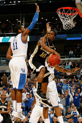 NEW ORLEANS - MARCH 20:  Ishmael Smith #10 of the Wake Forest Demon Deacons passes the ball around John Wall #11 of the Kentucky Wildcats during the second round of the 2010 NCAA men's basketball tournament at the New Orleans Arena on March 20, 2010 in Ne