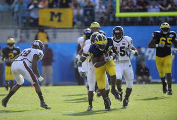 JACKSONVILLE, FL - JANUARY 01:  Kevin Koger #86 of the Michigan Wolverines breaks tackles following a reception against the Mississippi State Bulldogs during the Gator Bowl at EverBank Field on January 1, 2011 in Jacksonville, Florida  (Photo by Rick Dole