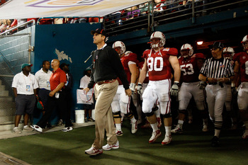 MIAMI, FL - JANUARY 03:  Head coach Jim Harbaugh of the Stanford Cardinal walks out of the tunnel to lead his team onto the field and play against the Virginia Tech Hokies during the 2011 Discover Orange Bowl at Sun Life Stadium on January 3, 2011 in Miam