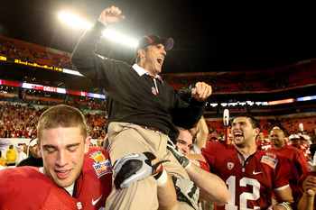 MIAMI, FL - JANUARY 03: Head coach Jim Harbaugh of the Stanford Cardinal celebrates as he is lifted up by his players including Orange Bowl MVP Andrew Luck #12 (R) after Stanford won 40-12 against the Virginia Tech Hokies during the 2011 Discover Orange B