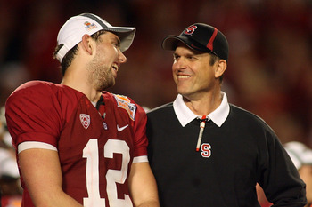 MIAMI, FL - JANUARY 03: (L-R) Quarterback Andrew Luck and head coach Jim Harbaugh of the Stanford Cardinal celebrate on stage after Stanford won 40-12 against the Virginia Tech Hokies during the 2011 Discover Orange Bowl at Sun Life Stadium on January 3,