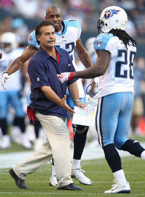 SEATTLE - AUGUST 14:  Head coach Jeff Fisher of the Tennessee Titans congratulates Chris Johnson #28 after scoring a touchdown during the preseason game against the Seattle Seahawks at Qwest Field on August 14, 2010 in Seattle, Washington. (Photo by Otto