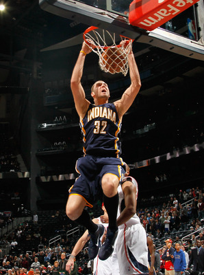 ATLANTA, GA - DECEMBER 11:  Josh McRoberts #32 of the Indiana Pacers dunks against the Atlanta Hawks at Philips Arena on December 11, 2010 in Atlanta, Georgia.  NOTE TO USER: User expressly acknowledges and agrees that, by downloading and/or using this Ph