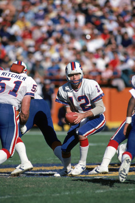 ANAHEIM, CA - NOVEMBER 27:  Quarterback Joe Ferguson #12 of the Buffalo Bills runs a play during a game against the Los Angeles Rams at Anaheim Stadium on November 27, 1983 in Anaheim, California.  The Rams won 41-17.  (Photo by George Rose/Getty Images)