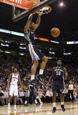 PHOENIX - DECEMBER 08:  Xavier Henry #13 of the Memphis Grizzlies slam dunks the ball against the Phoenix Suns during the NBA game at US Airways Center on December 8, 2010 in Phoenix, Arizona. NOTE TO USER: User expressly acknowledges and agrees that, by