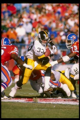 7 Jan 1990:  Fullback Merrill Hoge of the Pittsburgh Steelers runs with the ball during a game against the Denver Broncos at Mile High Stadium in Denver, Colorado.  The Broncos won the game 24-23. Mandatory Credit: Tim de Frisco  /Allsport