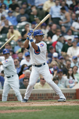 CHICAGO - APRIL 12: Ronnie Cedeno #5 of the Chicago Cubs stands ready at bat during the game against the Cincinnati Reds on April 12, 2006 at Wrigley Field in Chicago, Illinois. The Cubs defeated the Reds 4-1. (Photo by Jonathan Daniel\Getty Images)