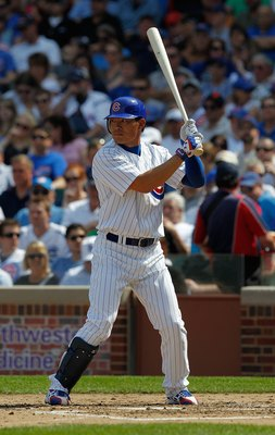 CHICAGO - APRIL 15: Kosuke Fukudome of the Chicago Cubs, wearing a number 42 jersey in honor of Jackie Robinson, prepares to bat against the Milwaukee Brewers at Wrigley Field on April 15, 2010 in Chicago, Illinois. The Brewers defeated the Cubs 8-6.  (Ph
