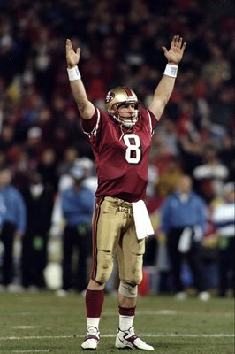 14 Dec 1998: Steve Young #8 of the San Francisco 49ers signals a touchdown during the game against the Detroit Lions at 3Com Park in San Francisco, California. The 49ers defeated the Lions 35-13. Mandatory Credit: Jed Jacobsohn  /Allsport