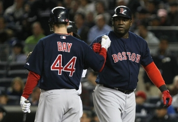 NEW YORK - SEPTEMBER 25:  Designated hitter David Ortiz #34 of the Boston Red Sox celebrates with teammate Jason Bay #44 after hitting a homerun in the sixth inning of the game against the New York Yankees at Yankee Stadium on September 25, 2009 in the Br