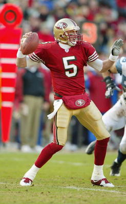 SAN FRANCISCO - DECEMBER 27:  Quarterback Jeff Garcia #5 of the San Francisco 49ers throws the ball downfield during the game against Seattle Seahawks on December 27, 2003 at Candelstick Park in San Francisco, California. The Seahawks won 24-17. (Photo by