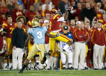 LOS ANGELES, CA - NOVEMBER 28:  Ronald Johnson #8 of the USC Trojans makes a catch while being pursued by Rahim Moore #3 of the UCLA Bruins in the second half at the Los Angeles Memorial Coliseum on November 28, 2009 in Los Angeles, California. USC defeat