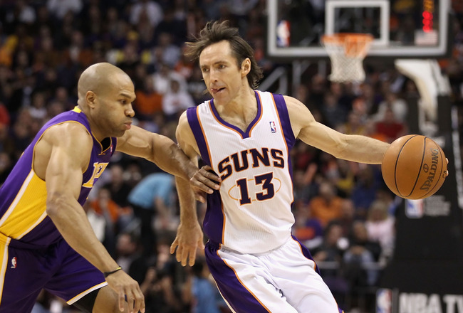 PHOENIX - JANUARY 05:  Steve Nash #13 of the Phoenix Suns handles the ball under pressure from Derek Fisher #2 of the Los Angeles Lakers during the NBA game at US Airways Center on December 23, 2011 in Phoenix, Arizona. NOTE TO USER: User expressly acknow