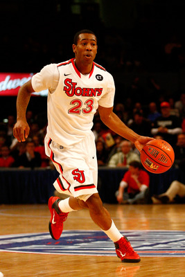 NEW YORK, NY - DECEMBER 20:  Paris Horne #23 of the St. John's Red Storm drives against the Davidson Wildcats during the Madison Square Garden Holiday Festival at Madison Square Garden on December 20, 2010 in New York City.  (Photo by Chris Chambers/Getty