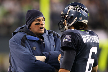 SEATTLE, WA - JANUARY 02:  (L-R) Quarterbacks Matt Hasselbeck #8 and Charlie Whitehurst #6 of the Seattle Seahawks speak on the sidelines during their game against the St. Louis Rams at Qwest Field on January 2, 2011 in Seattle, Washington.  (Photo by Ott